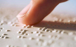 What is Braille and how is it used on signs in Australia?